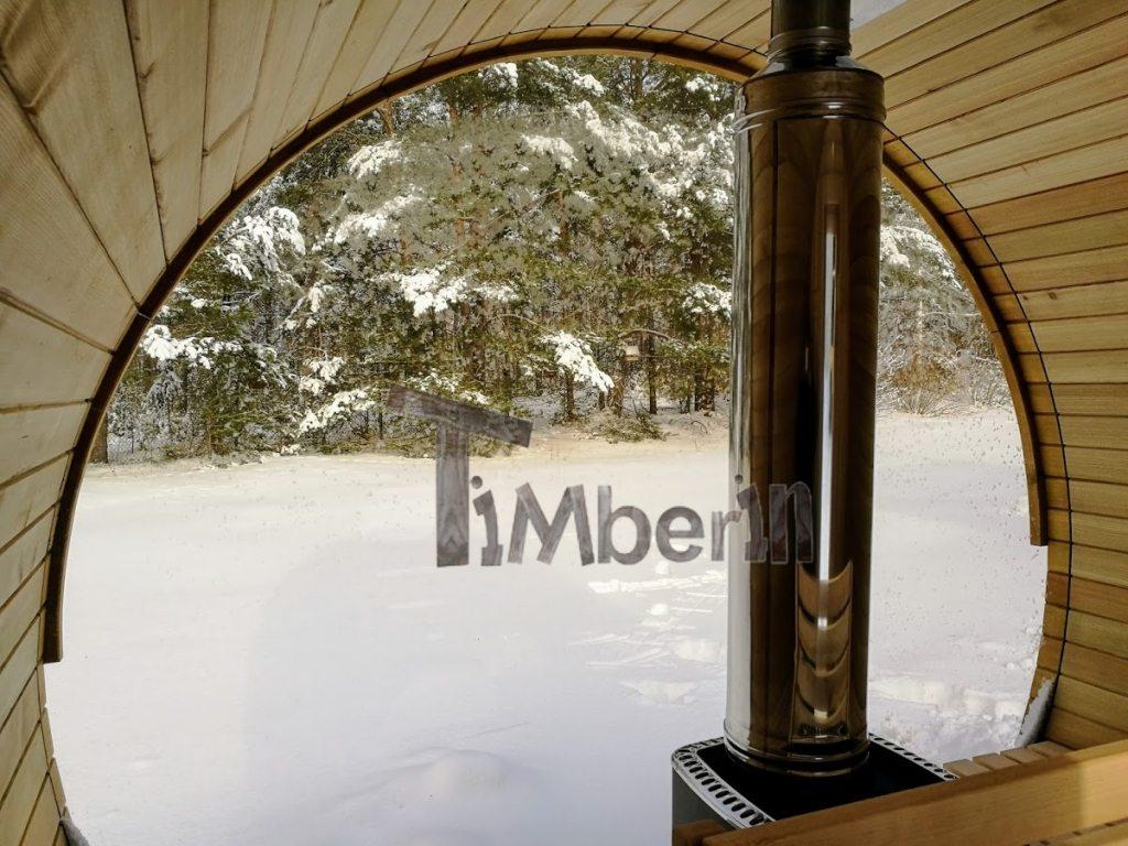 Außentonne-Gartensauna mit vollem Panoramafenster im Winter